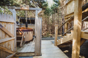 Private wood-fired hot tub next to dome